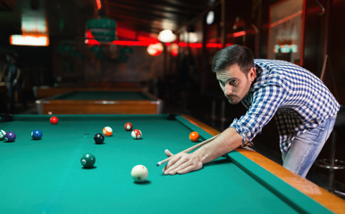 Man playing pool in pub