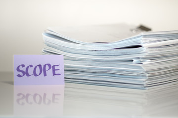 Scope; Stack of Documents on white desk and Background.