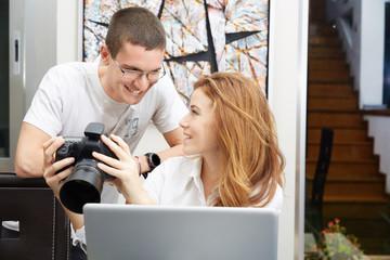 Participants of a photo workshop looking at camera display