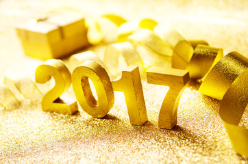 Fototapete - Closeup gold wood 2017 with Gift and ribbon and lighting effect background, New year decoration.