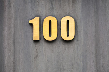 number 100 on the wall of a building