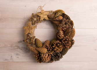Holiday wreath made of pine cones