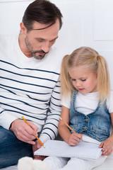 Serious good looking man explaining something to his daughter