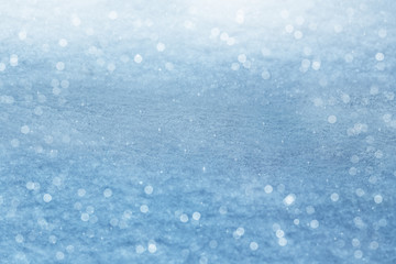 Winter background. Sparkling snow with bokeh
