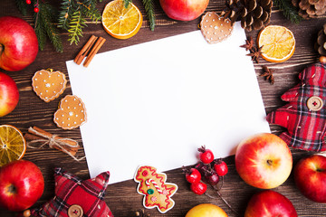 Christmas Holiday background with apples and decorations over wooden table