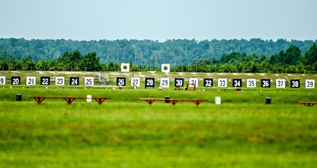 Targets for a shooting range with bulls-eye's are lined up in a