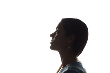 Young woman looking up - horizontal silhouette