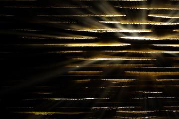 Shining light through slats