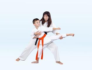 Karateka beats kicking trainer corrects