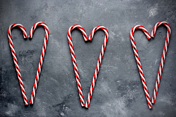 Candy cane hearts holiday background