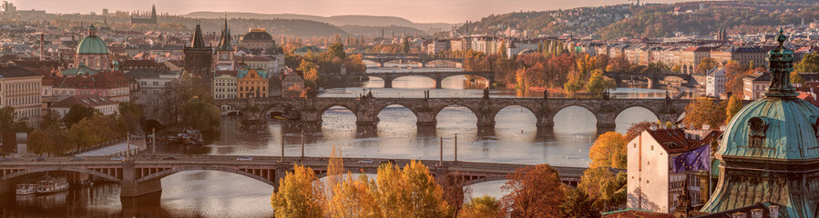 Prague panorama with bridges on river Vltava at early autumn mor