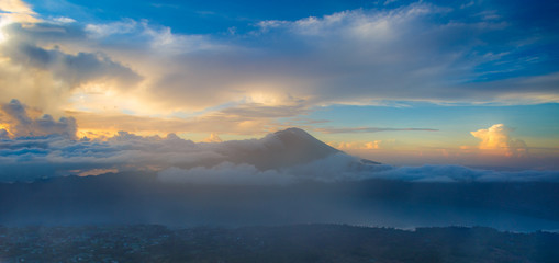 Indonesian Volcano In Blue Cky With Orange Clouds at Sunrise Mor