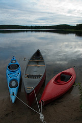 kayaks and canoes moored at shore