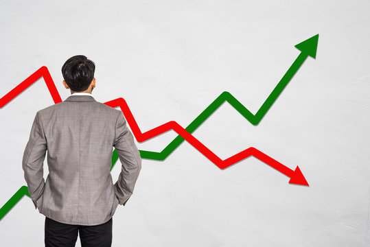 Back view of standing businessman looking stock market graph on white background