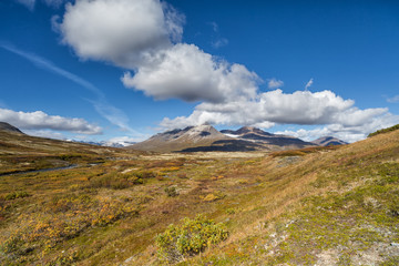 Indian summer landscape in the Yukon in Canada with cloud format