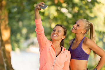 Beautiful girls taking a selfie with a smart phone.