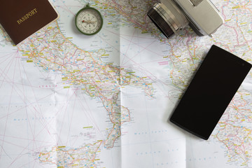 Passport and tourist accesories on the map of Europe, travel con