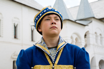 Portrait boy in national russian suit  in Kremlin Rostov Great