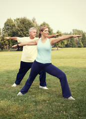 Senior couple yoga.