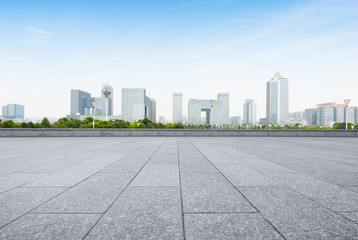 cityscape and skyline of nanjing from empty brick floor