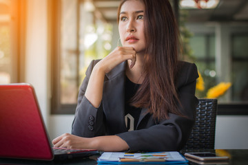 Businesswoman thinking about business profits quarter of year at office