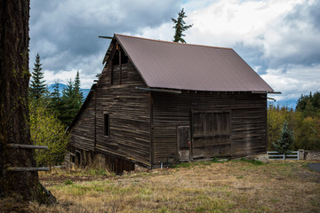 An old barn in the hills above the trees