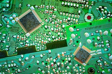close up of two green circuit boards