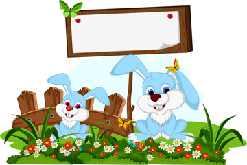 two rabbit cartoon posing with blank sign