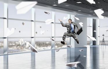 Dancing businessman in office room