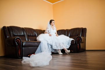 bride on the leather sofa