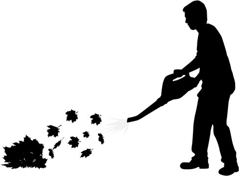 Silhouette of a man with a leaf blower.