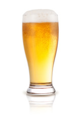Fresh beer in a glass isolated on a white background