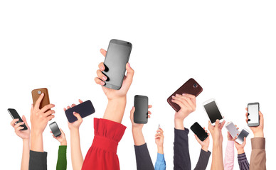 Many hands holding mobile phones on white background