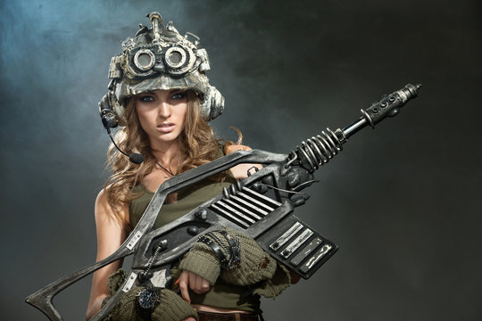 Beautiful woman warrior with a weapon
