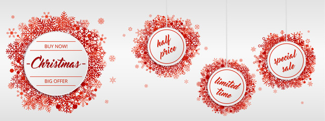 Christmas sales with red snowflakes on white background