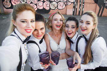 Friends, bachelorette party and holidays concept - happy smiling young pretty women with champagne glasses taking selfie at night club
