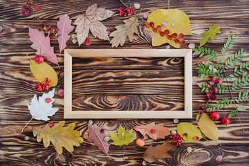 Composition with autumn leaves and picture frame. Flat lay, copy space.