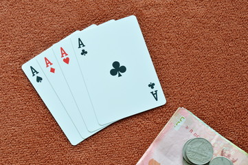 play card showdown ace and money on table