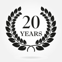 20 years anniversary laurel wreath sign or emblem. Template for celebration and congratulation design. Vector 20th anniversary label isolated on white background.