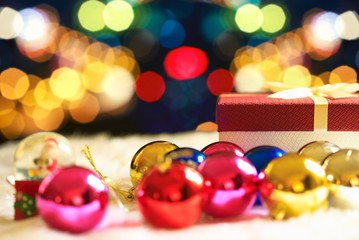 Red Christmas gift box and bokeh on background