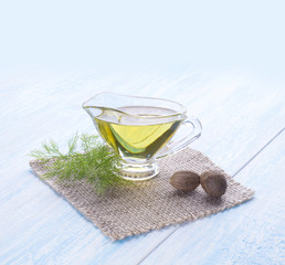 olive oil in glass gravy boat.   and nutmeg
