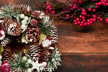 Christmas wreath and branch with red fruits