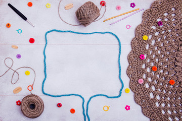 Crochet accessories frame, knit lessons. Balls of yarn with needles and crochets on white background, copy space for text. Leisure, handiwork, hobby concept