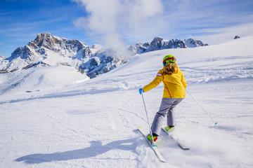 Teenage girl skiing in Italian Alps in Sunny Day, San Martino di