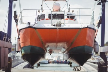 Boat on a hydro hoist boatlift