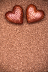 Two wooden hearts on rustic wood background. Valentines days con