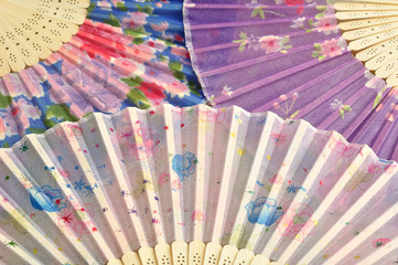 Collection of colorful hand fans