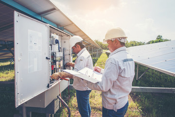 engineer or electrician working on  maintenance equipment at industry solar power