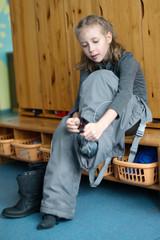 Little girl dressing up in kindergarten.