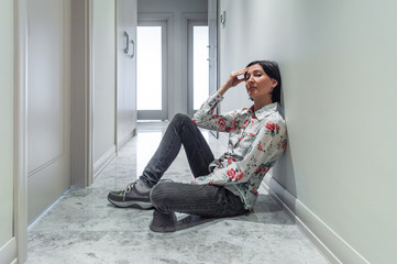 Bored Woman Sitting on the Floor Alone